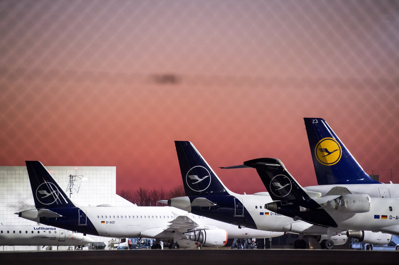 This picture released on March 26, 2020, shows Lufthansa aircraft parked at the airport in Munich, Germany on March 25, 2020. (EPA Photo)