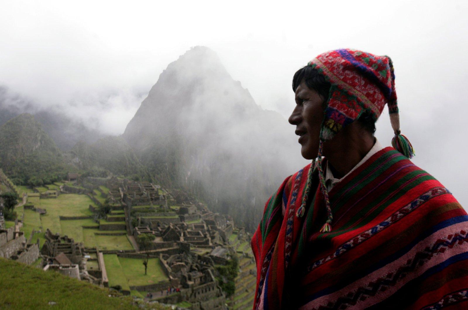 A Quechua musician stands next to the Machu Picchu ruins, Peru, April 1, 2010. (Reuters Photo)