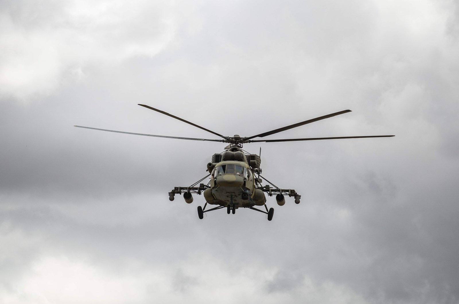 A Russian military helicopter monitors the M4 highway by the town of Tal Tamr, northeastern Syria, May 25, 2020. (AFP Photo)