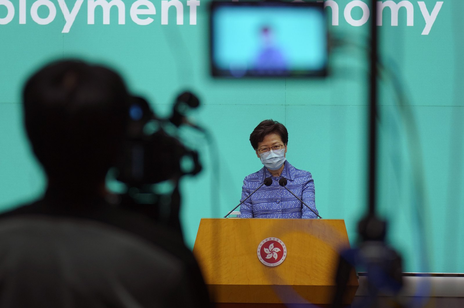 Hong Kong Chief Executive Carrie Lam listens to reporters' questions during a press conference in Hong Kong, Tuesday, May 26, 2020. (AP Photo)