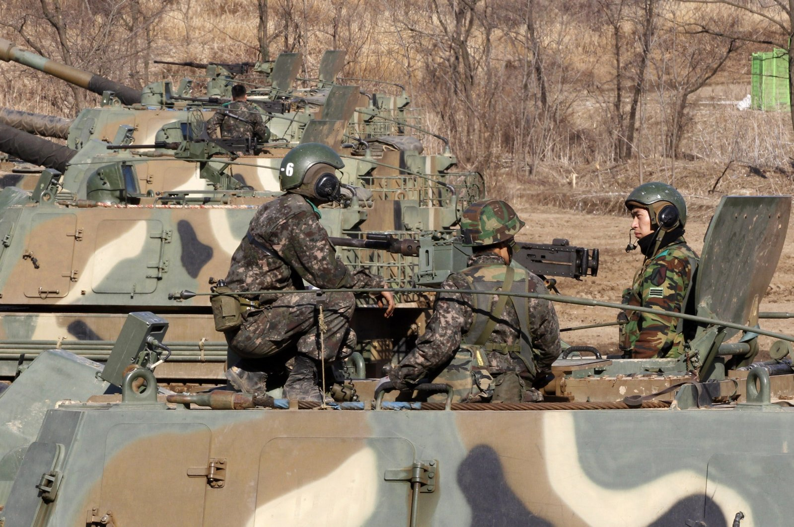 South Korean Army soldiers sit on their K-9 self-propelled artillery vehicle during an exercise against possible attacks by North Korea near the border village of Panmunjom in Paju, South Korea, March 11, 2013. (AP Photo)