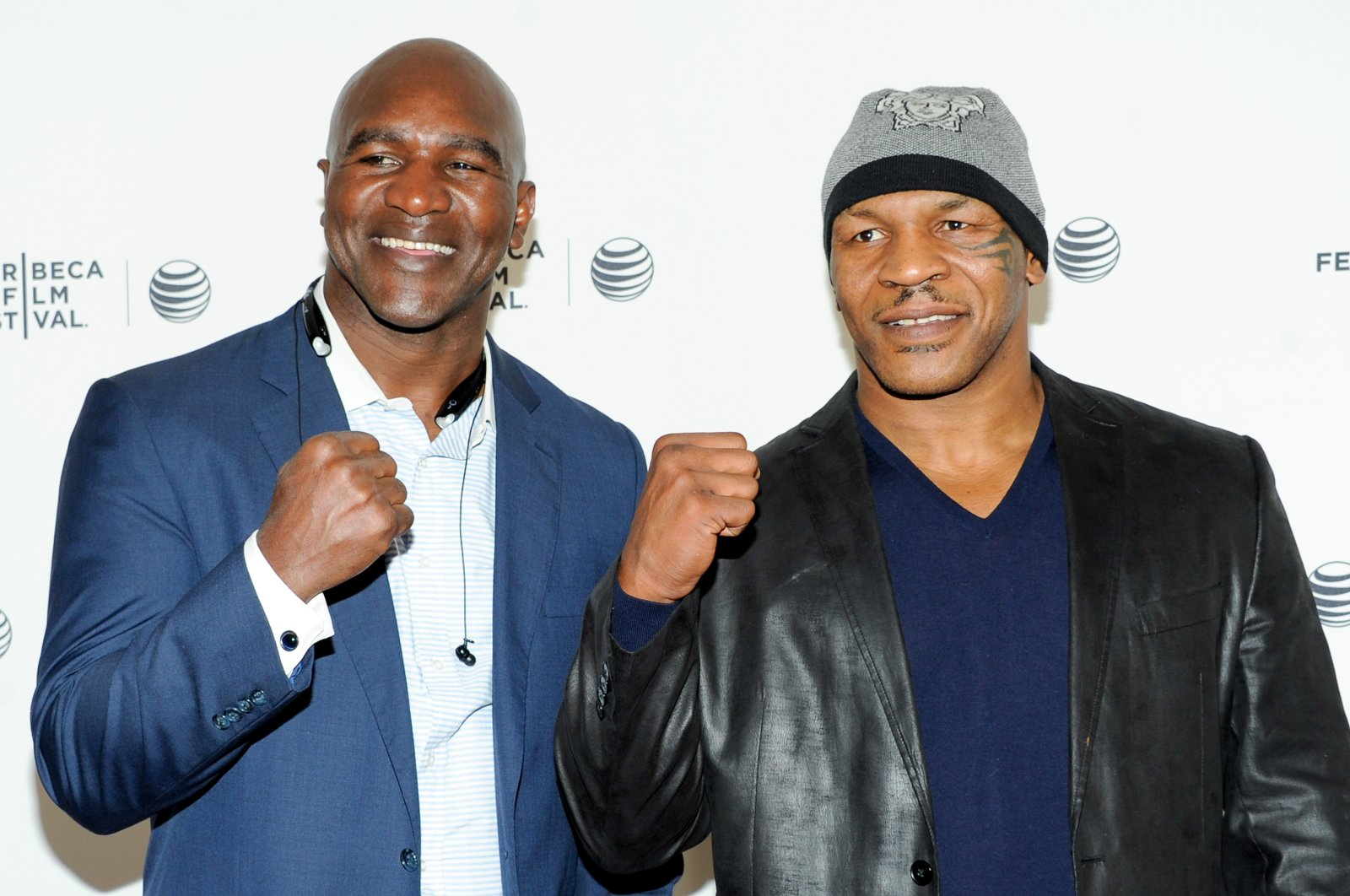 Evander Holyfield (L) and Mike Tyson pose together at an event in New York, U.S., April 19, 2014. (AP Photo)