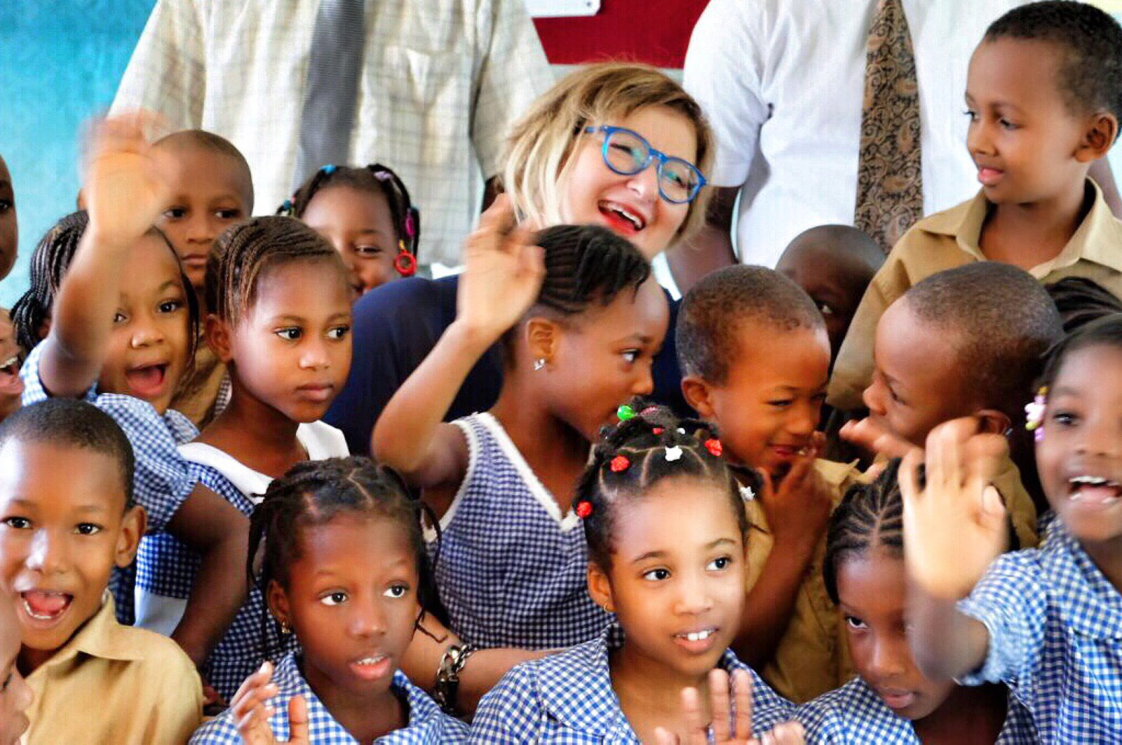 Nur Sağman, deputy general director for Africa at the Turkish Foreign Ministry, alongside with African children. (AA)