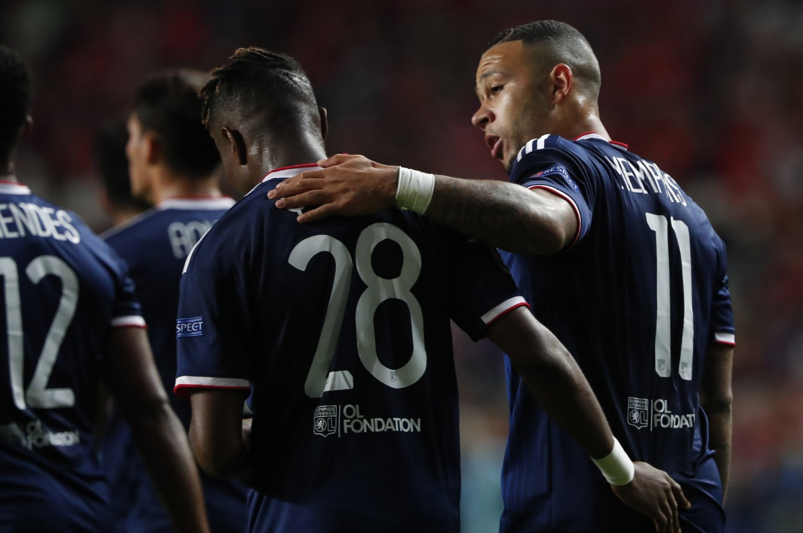 Lyon players celebrate a goal during a Champions League match against Benfica in Lisbon, Portugal, Oct. 23, 2019. (AP Photo)