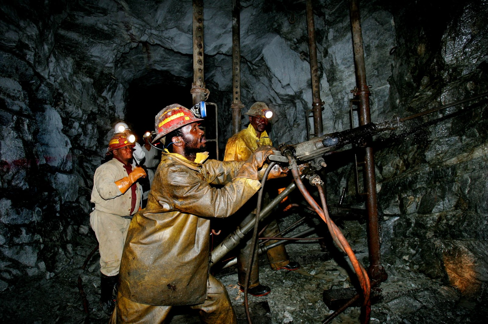 This file photo from Sept. 22, 2005, shows Gold miners working deep underground at Cooke Shaft near Johannesburg, South Africa. (Reuters Photo)