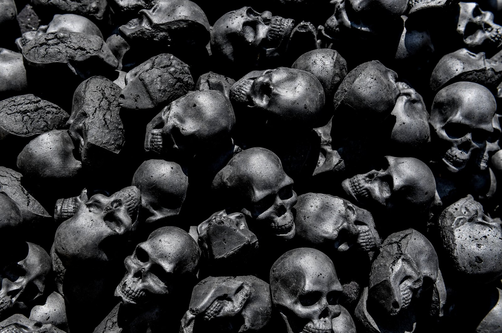 Black skulls made from coal displayed during a Victorian picnic at the Clara Zetkin Park during a Gothic Meeting in Leipzig, Germany, June 7, 2019 (EPA Photo)