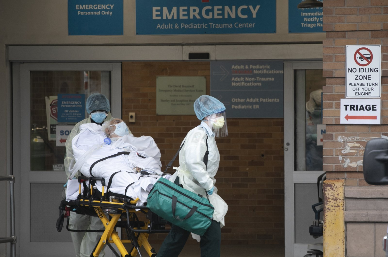A patient is moved by healthcare workers at Maimonides Medical Center, Wednesday, May 6, 2020, in New York during the coronavirus pandemic. (AP Photo)