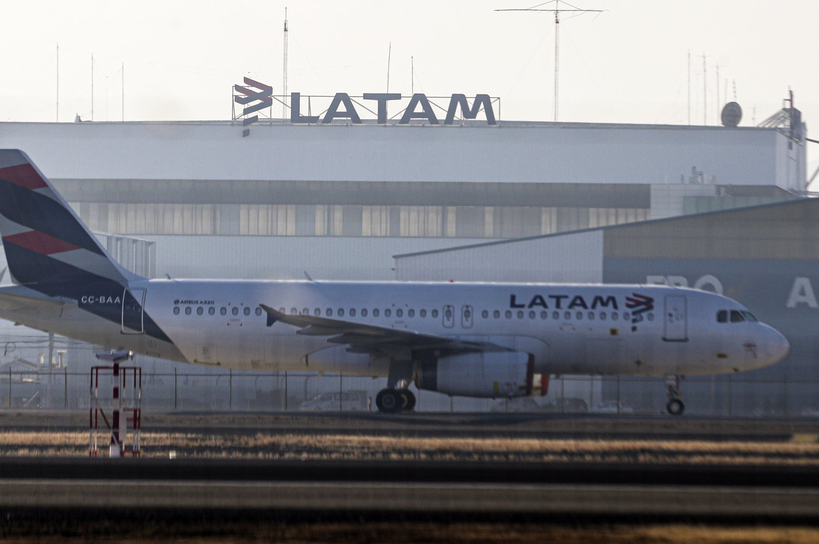 A Latam airplane sits parked at the Arturo Merino Benitez airport in Santiago, Chile, Tuesday, May 26, 2020. (AP Photo)