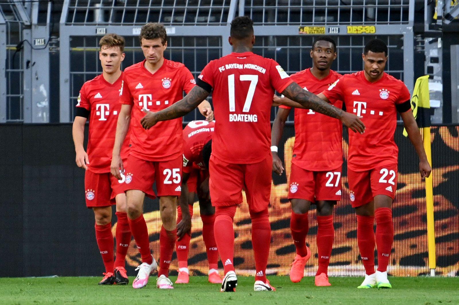 Bayern Munich players celebrate scoring a goal during Bundesliga football match between Borussia Dortmund and Bayern Munich, in Dortmund, Germany, May 26, 2020 (AFP Photo)