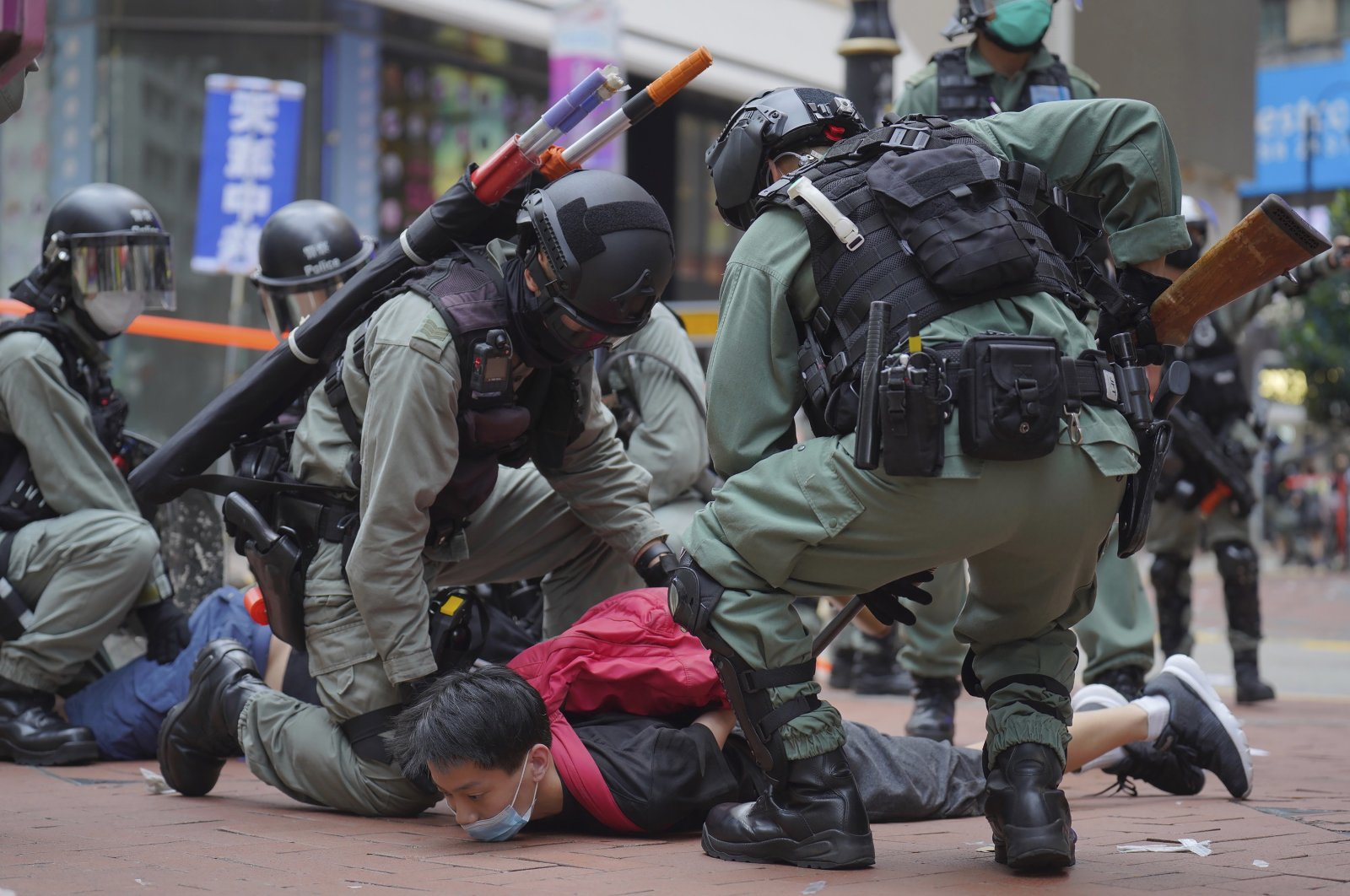 Riot police detain a protester during a demonstration against Beijing's national security legislation in Causeway Bay in Hong Kong, Sunday, May 24, 2020. (AP Photo)