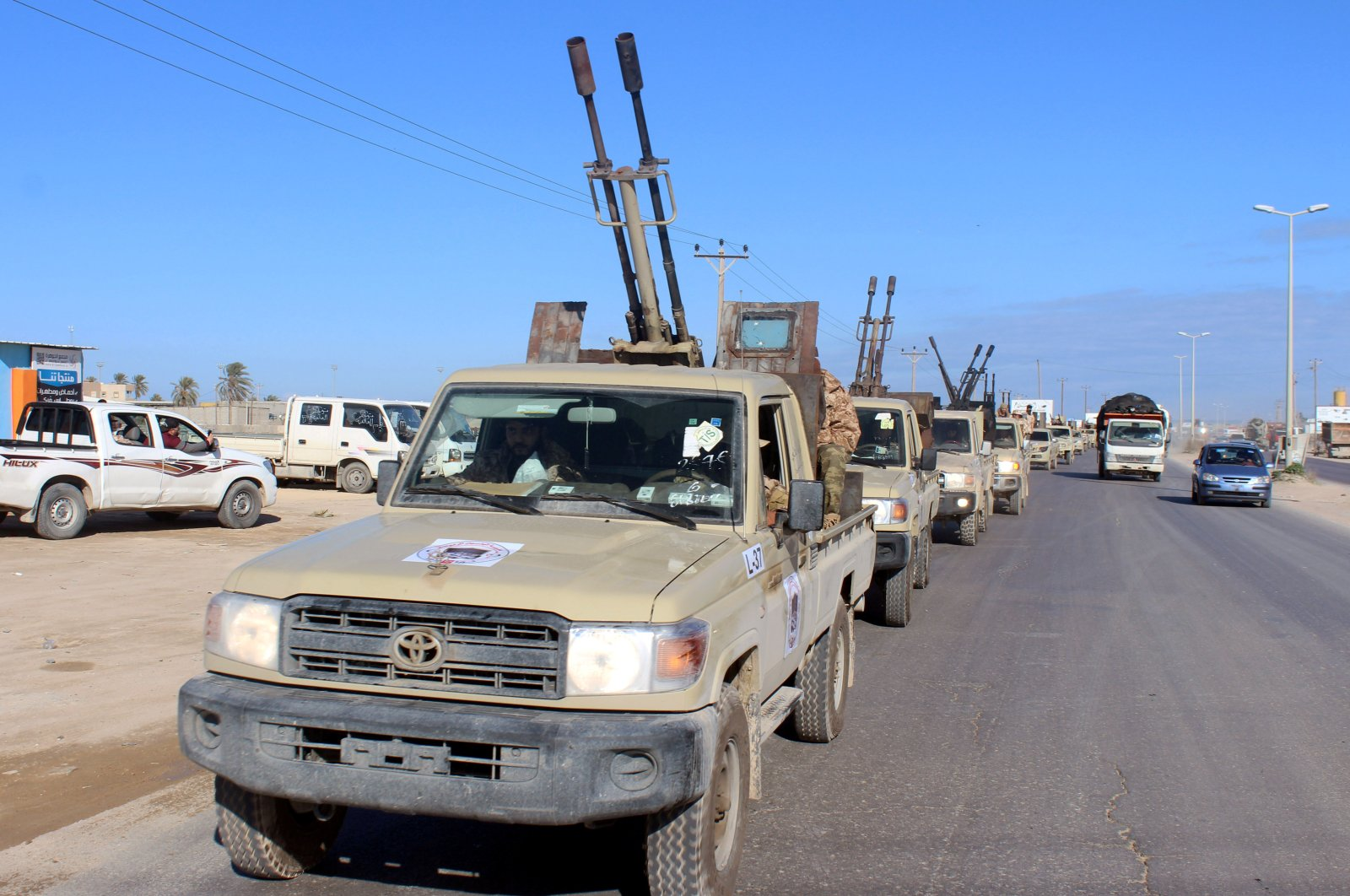 Military vehicles of the Libyan internationally recognized government forces head out to the front line from Misrata, Libya Feb. 3, 2020. (Reuters Photo)
