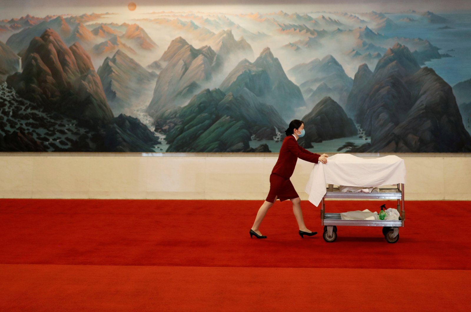 An attendant wearing a face mask following the coronavirus outbreak pushes a cart at the Great Hall of the People after the opening session of the National People's Congress (NPC) in Beijing, China, May 22, 2020. (Reuters Photo)