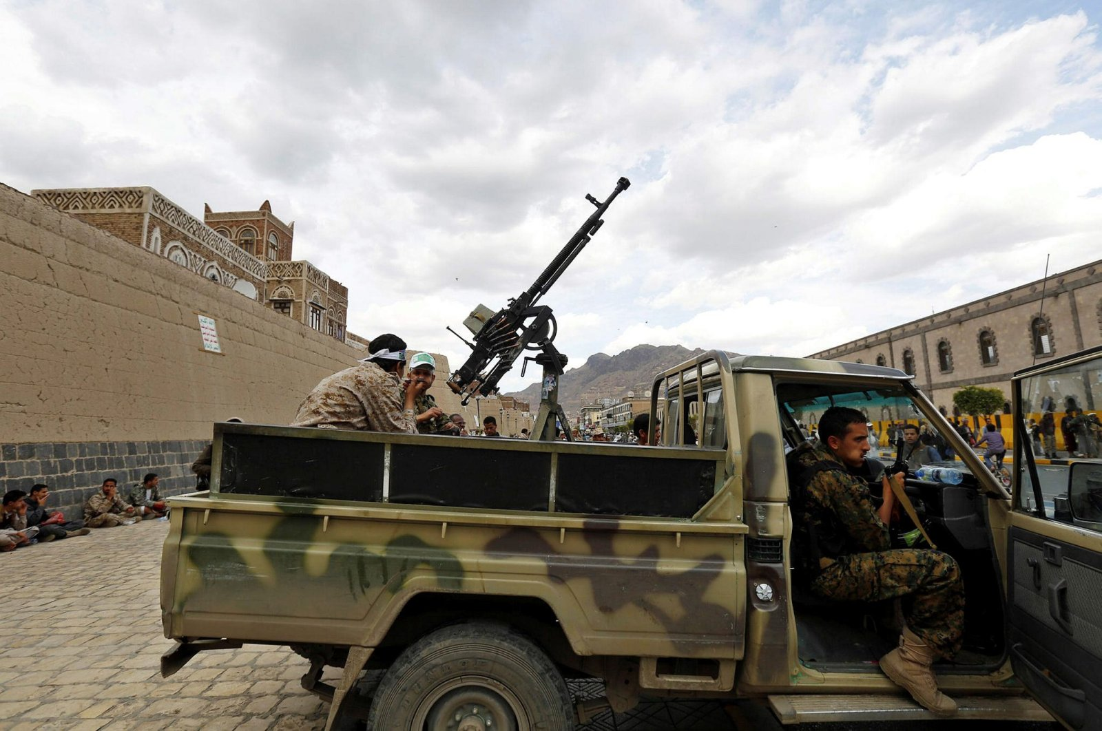 This undated file photo shows Yemen's Houthi fighters manning a heavy machine gun fixed on the back of a pickup truck. (File Photo)