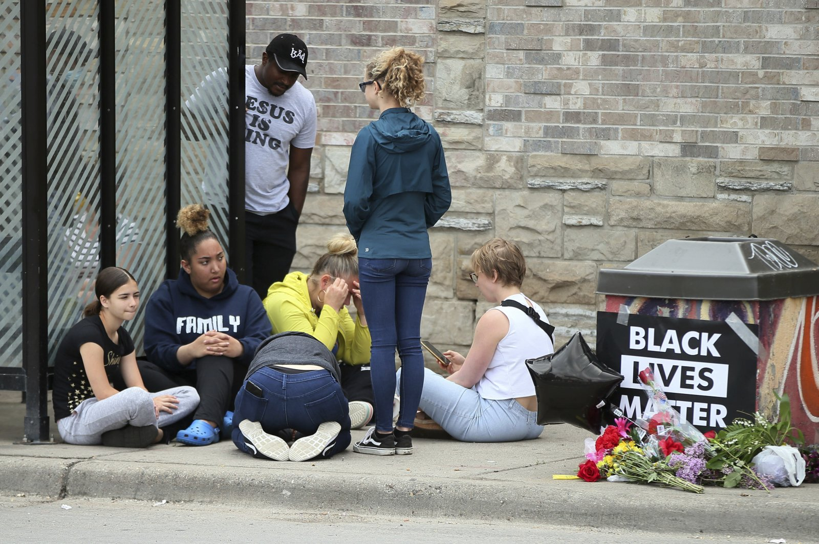 Mourners gather around a makeshift memorial near where a black man was arrested by police and later died, Minneapolis, Minnesota, May 26, 2020. (AP Photo)