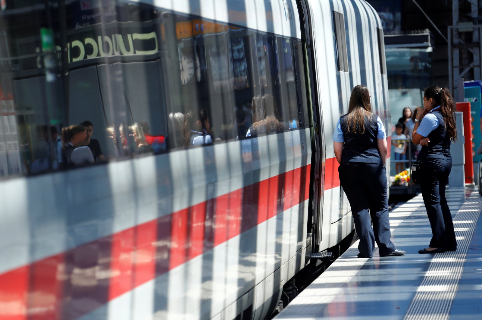 Deutsche Bahn employees stand next to an ICE high-speed train at the main train station in Frankfurt, Germany, July 30, 2019.  (Reuters Photo)