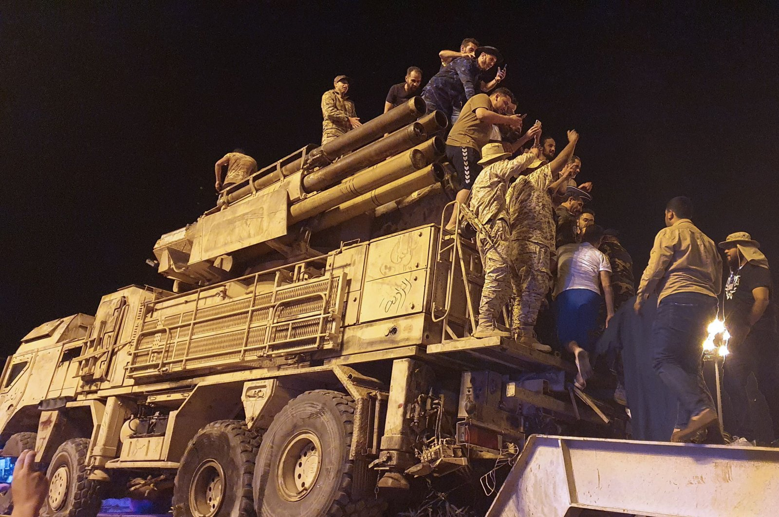 Forces loyal to Libya's U.N.-recognised Government of National Accord (GNA) parade a Pantsir air defense system truck in the capital Tripoli on May 20, 2020, after its capture at al-Watiya airbase (Okba Ibn Nafa airbase) from forces loyal to Libya's eastern-based strongman Khalifa Haftar. (AFP Photo)
