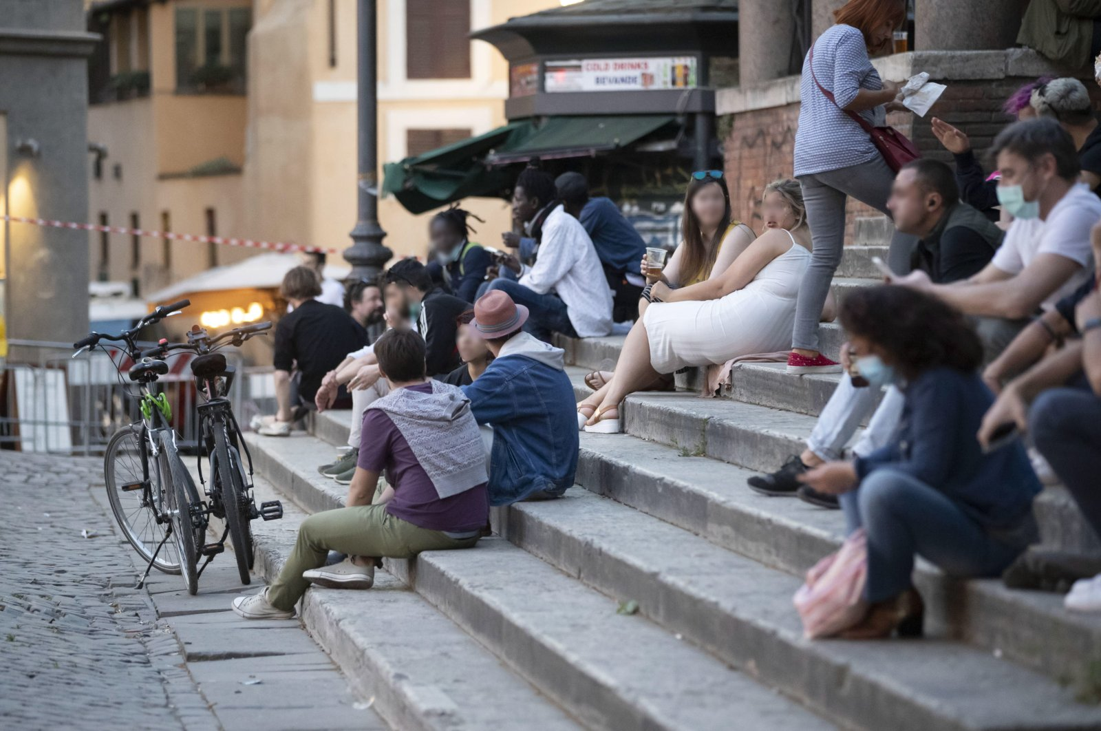 Groups of young people gather at night in bars or cafes to spend the night at Trastevere district in Rome, Italy, 21 May 2020.