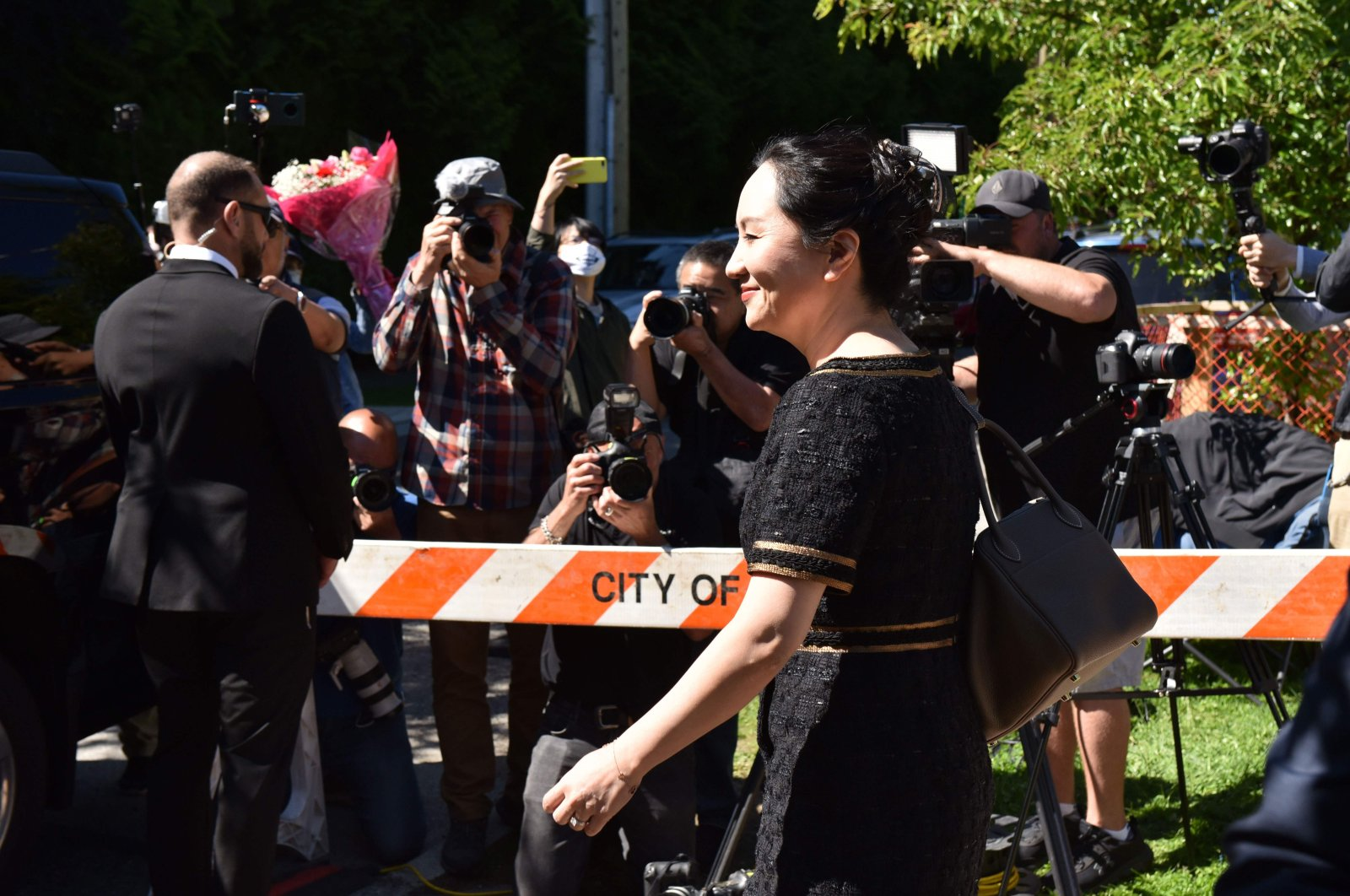 Chinese Huawei tech executive Meng Wanzhou leaves her Vancouver home to appear in British Columbia Supreme Court, May 27,2020. (AFP)
