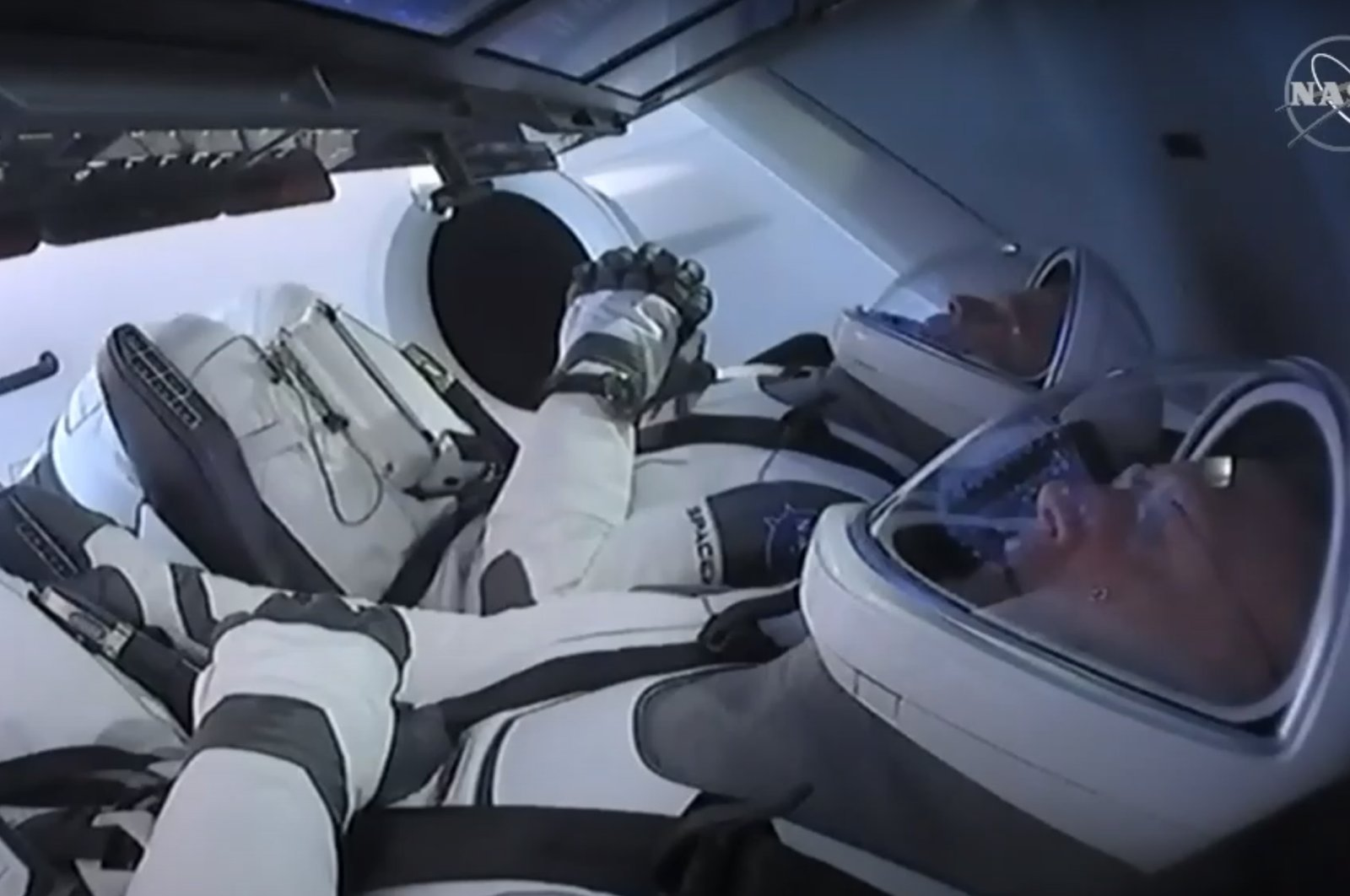 This still image taken from NASA TV, shows the SpaceX Crew Dragon capsule, with astronauts Bob Behnken (front) and Doug Hurley, at Launch Complex 39A in Kennedy Space Center in Florida on May 27, 2020. (AFP Photo/NASA TV)