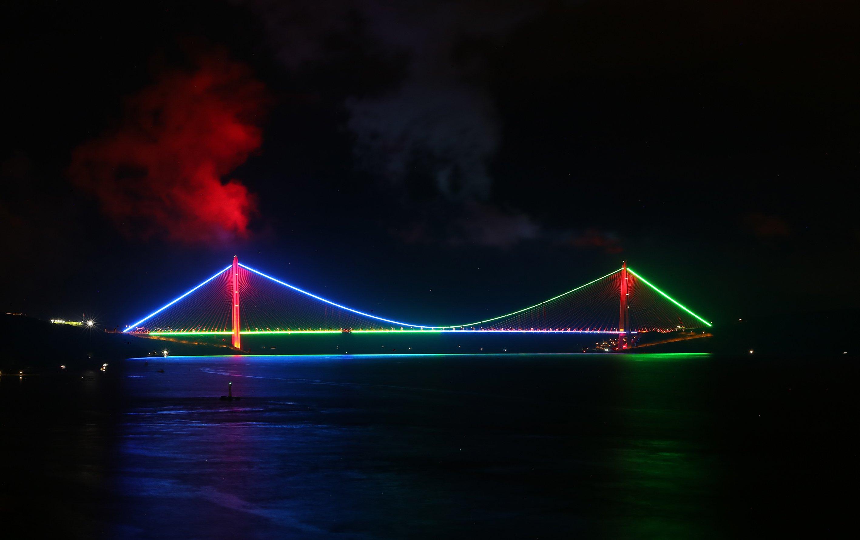 Istanbul's Fatih Sultan Mehmet Bridge lit in colors of the Azerbaijani flag on May 28, 2020 (AA Photo)