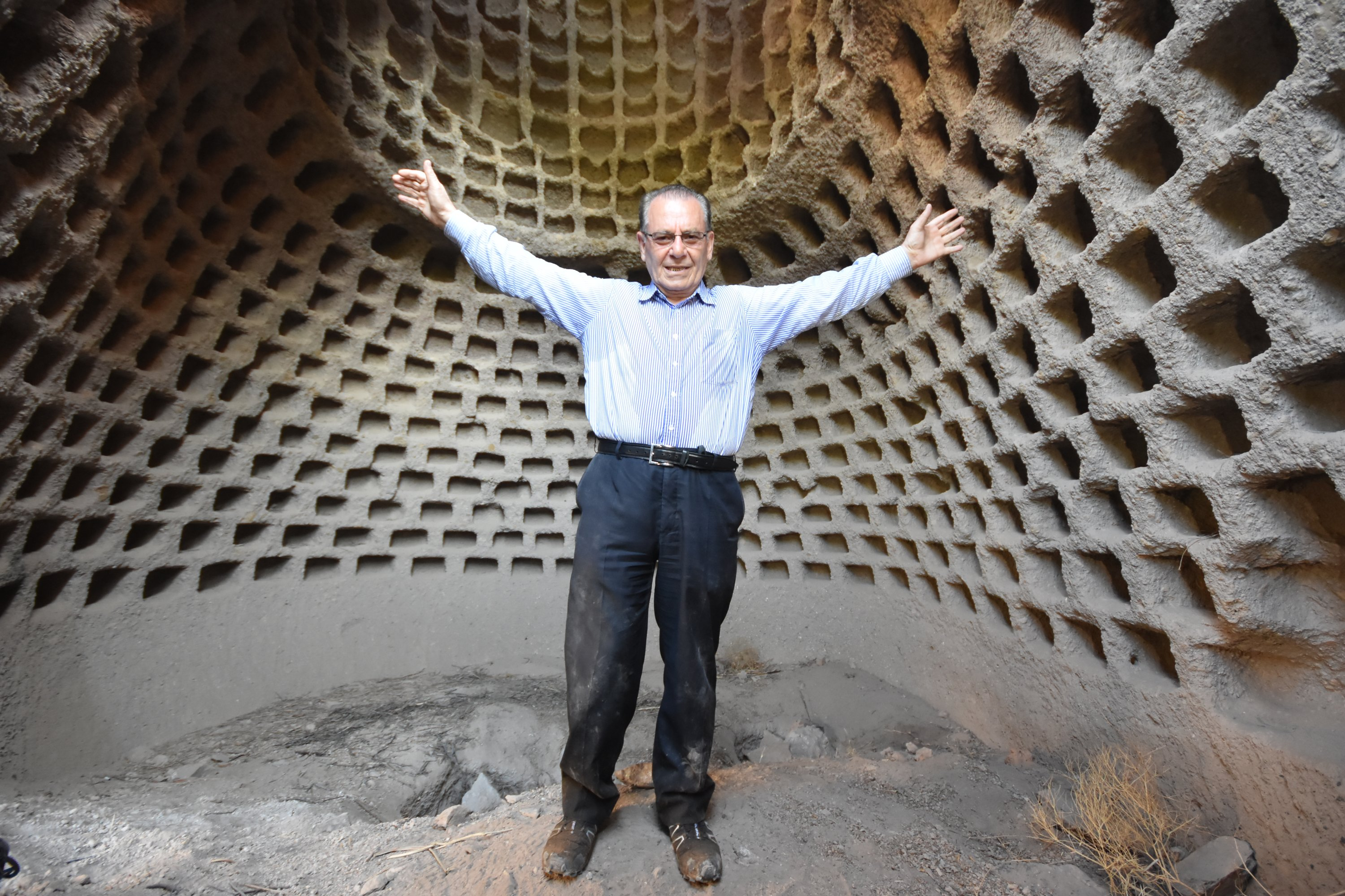 Sezai Yazıcı poses in front of the dovecotes. (AA Photo)