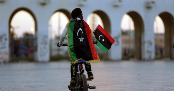 A boy wearing a Libyan flag takes part in a celebration marking the sixth anniversary of the Libyan revolution, in Benghazi, Libya, Feb. 17, 2017. (Reuters Photo)