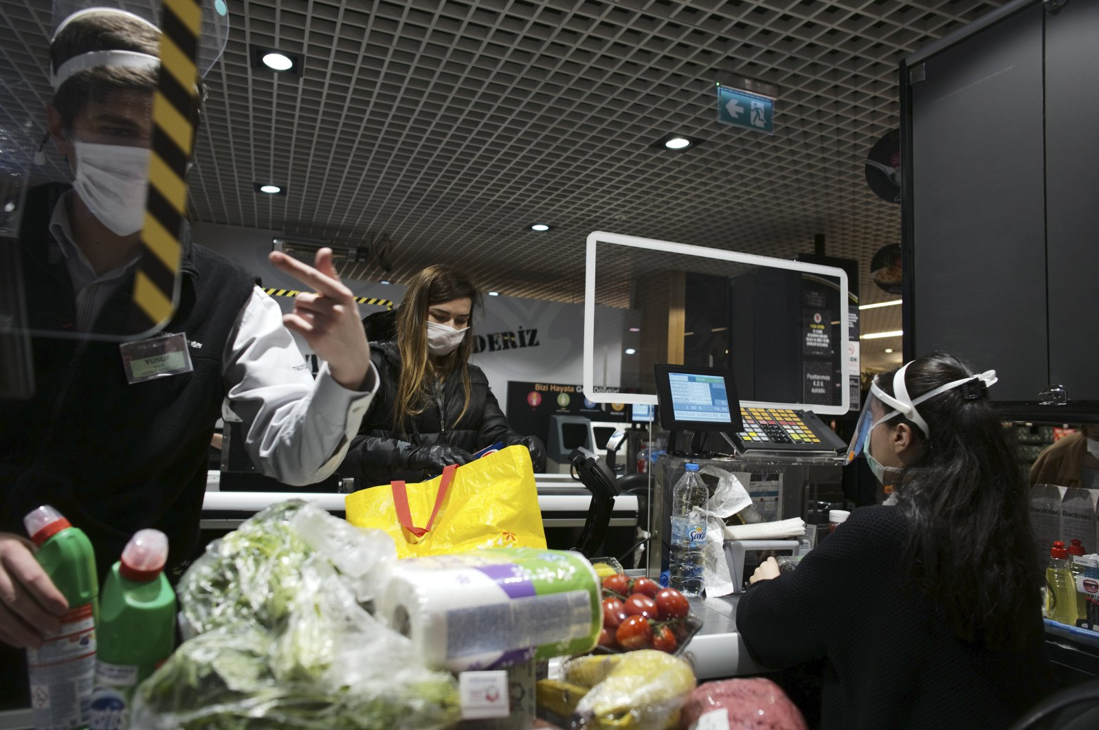 People wearing face masks shop for food at a market during the coronavirus outbreak, Ankara, Turkey, April 21, 2020. (AP Photo)