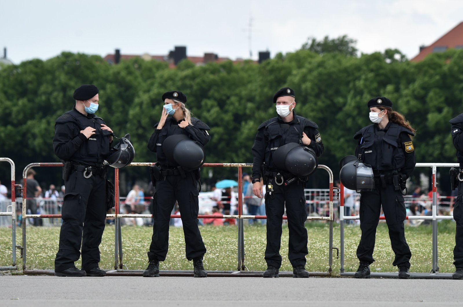 Police officers stand guard in front of a demonstration, Munich, Germany, May 23, 2020. (AFP Photo)