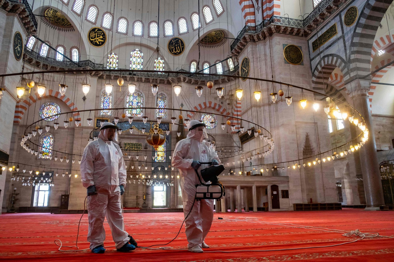 Fatih Municipality workers disinfect the Suleymaniye Mosque before its reopening on the last day of Ramadan Bayram amid the coronavirus pandemic, Istanbul, May 26, 2020. (AFP Photo)