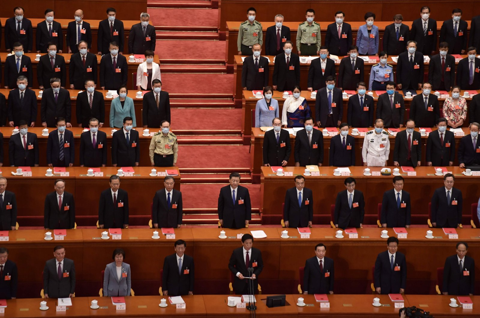 Chinese President Xi Jinping (C) stands with other Chinese leaders at the end of the closing session of the National People's Congress at the Great Hall of the People, Beijing, May 28, 2020. (AFP Photo)