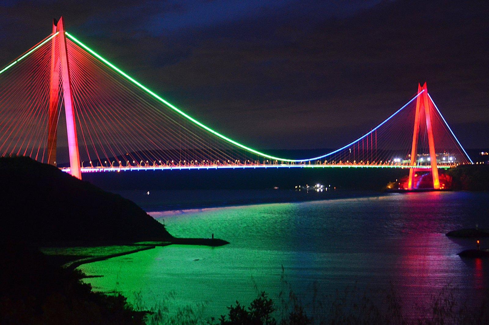 Istanbul's Yavuz Sultan Selim Bridge lit in colors of the Azerbaijani flag on May 28, 2020 (AA Photo)