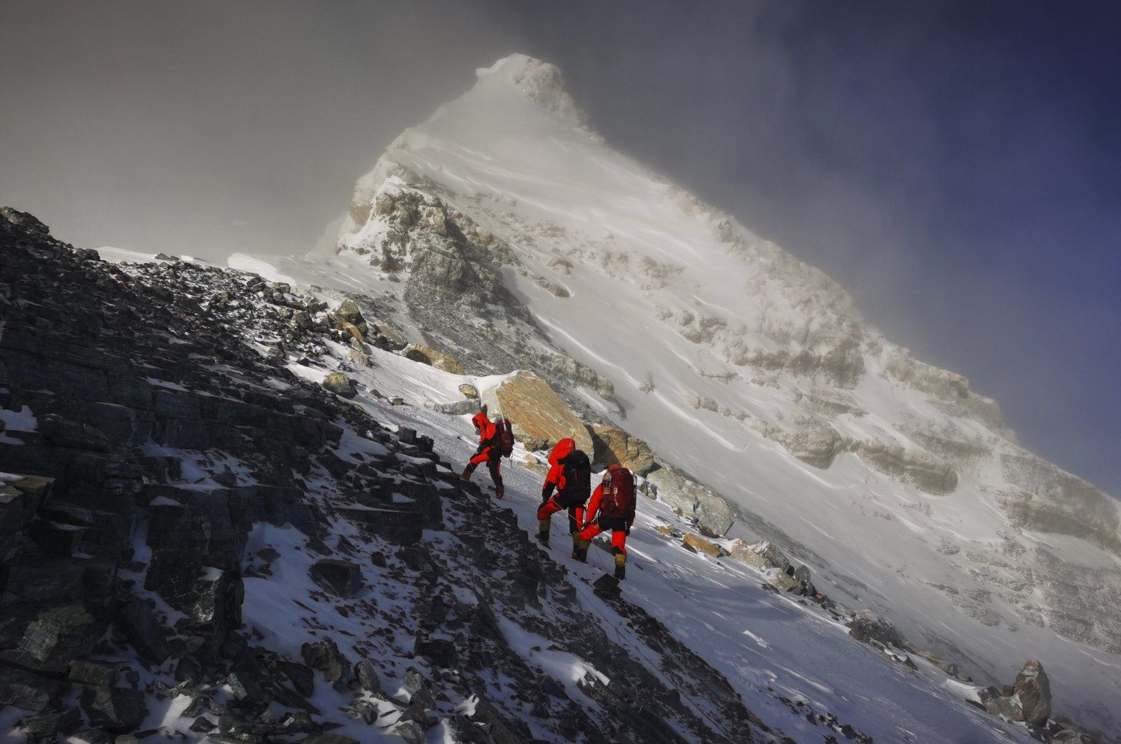In this photo released by Xinhua News Agency, members of a Chinese surveying team head for the summit of Mount Everest, also known locally as Mt. Qomolangma, May 27, 2020. (AP Photo)
