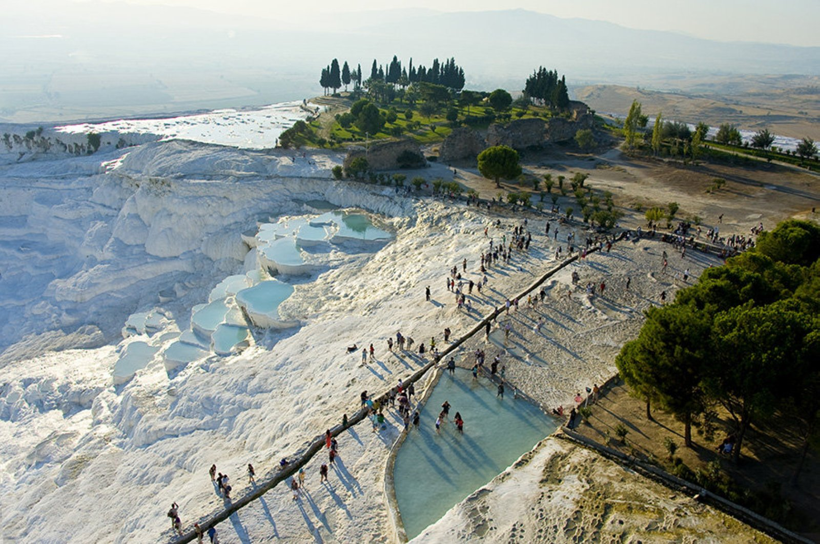 The Pamukkale travertines in western Turkey's Denizli province are an important health tourism destination of Turkey, with their thermal facilities that provide high-quality medical treatment to foreigners at affordable prices. (File Photo)