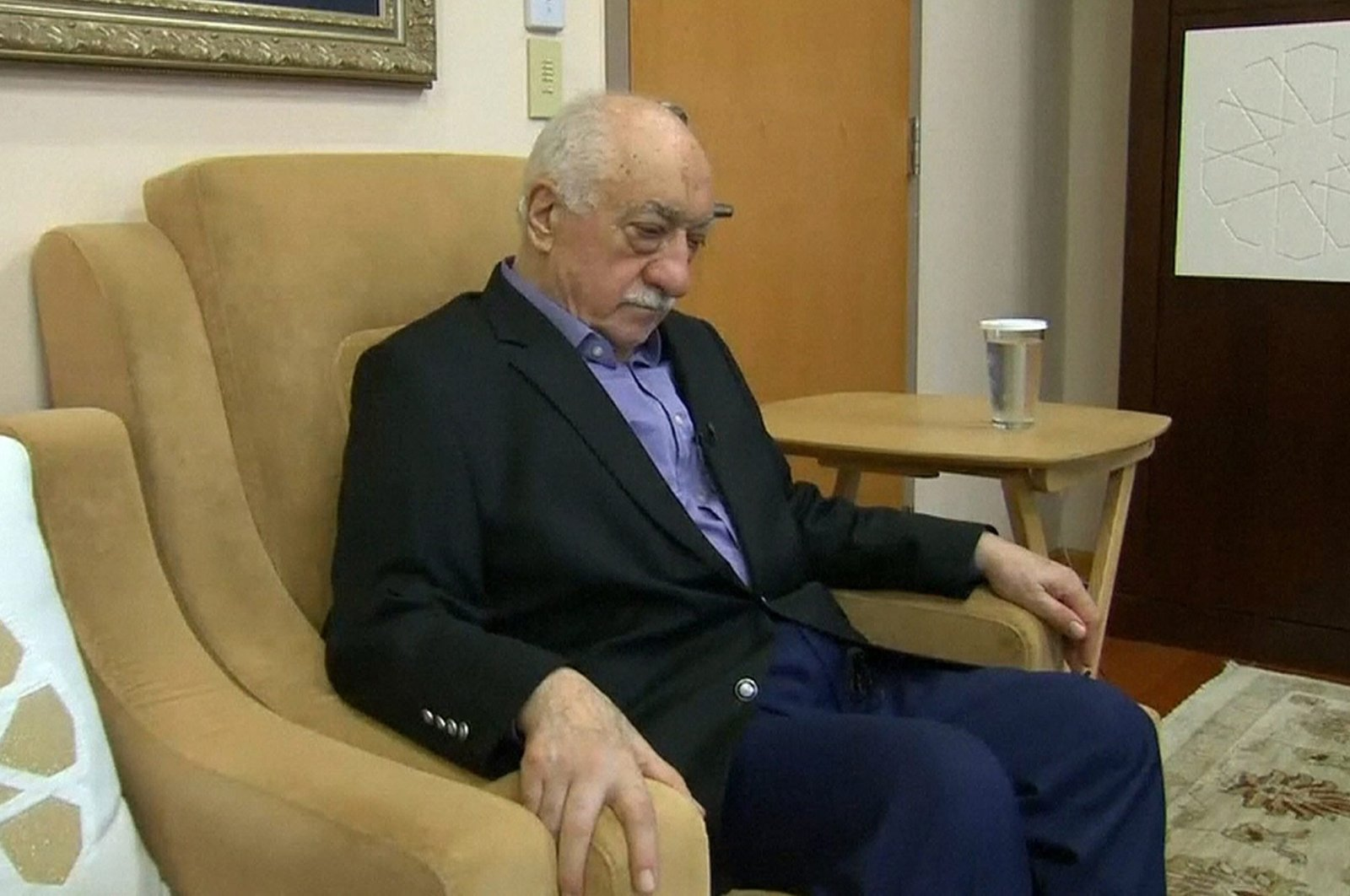 U.S.-based Gülenist Terror Group (FETÖ) leader Fethullah Gülen pauses before speaking to journalists in this still image taken from video, at his home in Saylorsburg, Pennsylvania, U.S., July 16, 2016. (Reuters Photo)