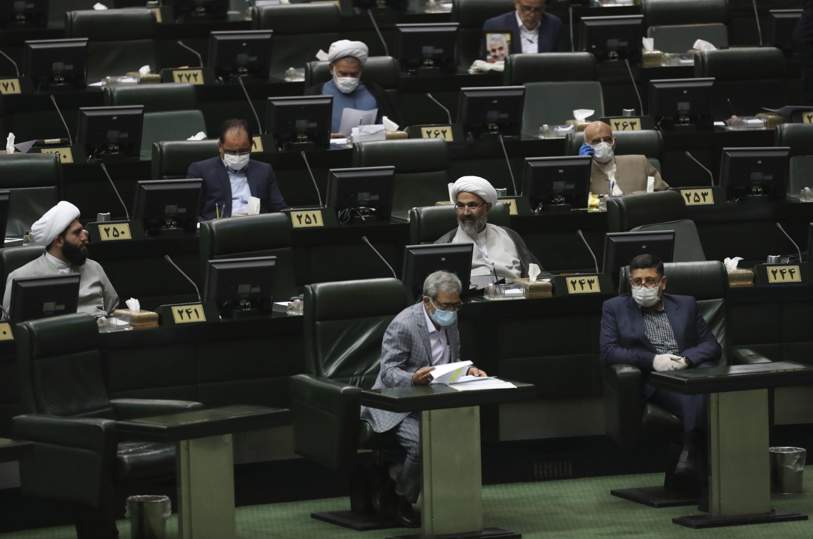 Lawmakers attend a session of the parliament in Tehran, Iran, May 28, 2020. (AP Photo)