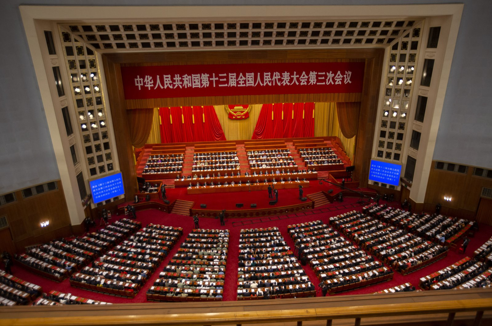 Delegates and Chinese leaders attend the closing session of China's National People's Congress (NPC) in Beijing, Thursday, May 28, 2020. China's ceremonial legislature has endorsed a national security law for Hong Kong that has strained relations with the United States and Britain. (AP Photo)