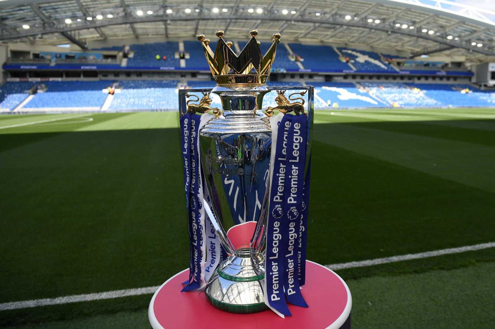 In this file photo taken on August 12, 2017, The Premier League trophy sits beside the pitch ahead of the English Premier League football match between Brighton and Hove Albion and Manchester City at the American Express Community Stadium in Brighton. (AFP Photo)