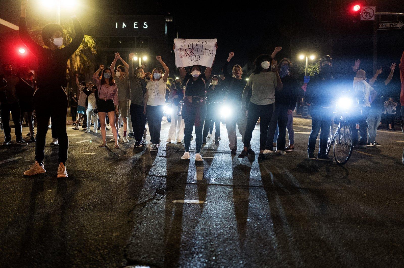 Demonstrators block traffic during a protest over the death of George Floyd in Minneapolis police custody earlier in the week, May 27, 2020, in Los Angeles. (AP Photo)