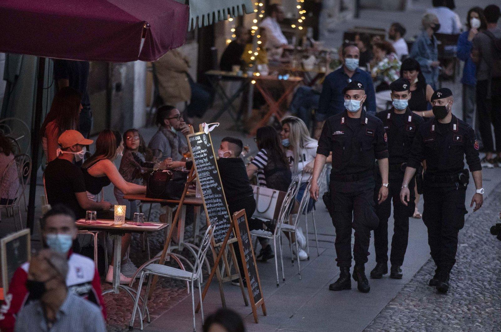 Carabinieri officers patrol the city trendy Navigli district in Milan, Italy, Tuesday, May 26, 2020. (AP Photo)