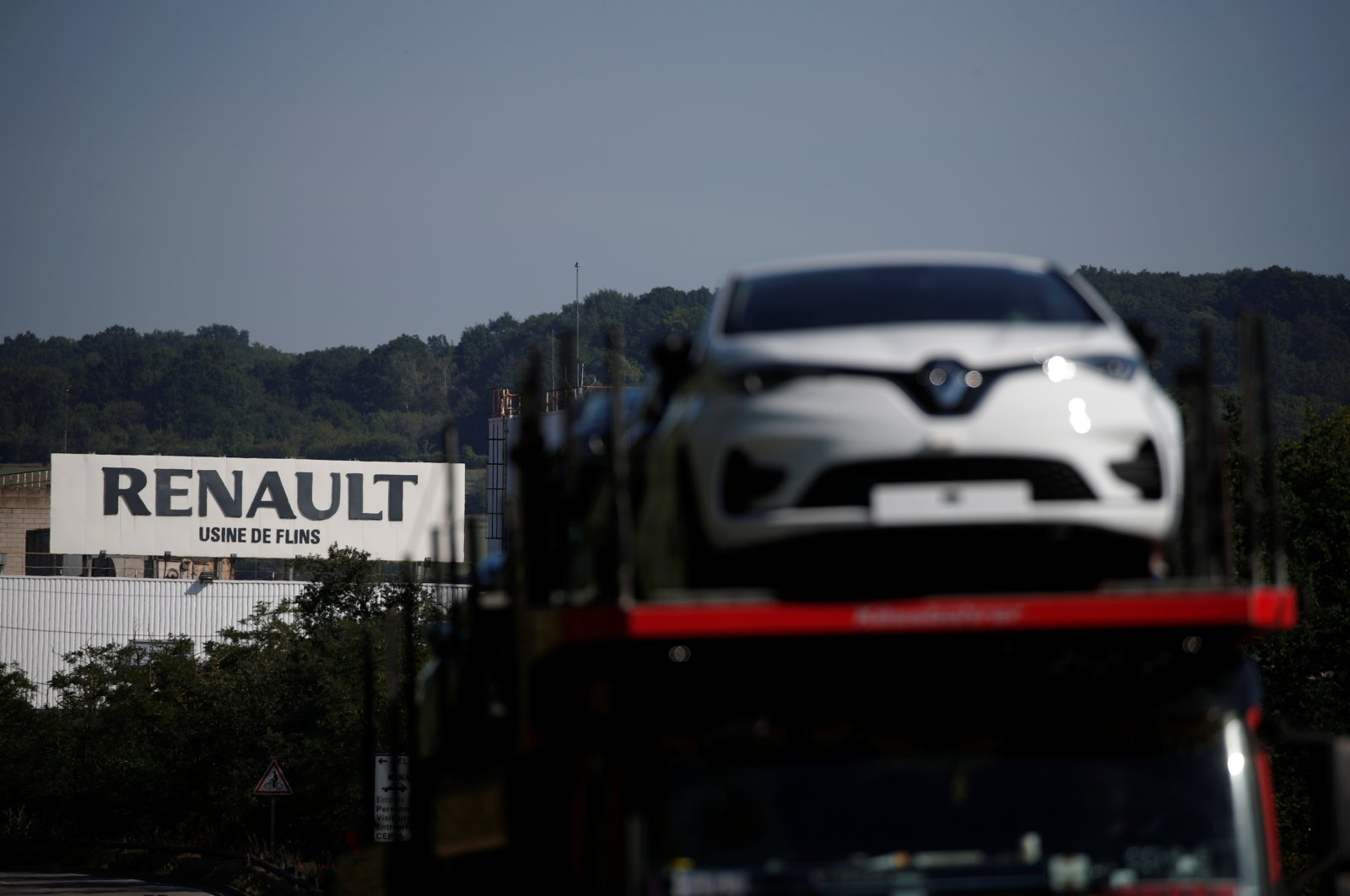 A car carrier transporting Renault ZOE cars leaves the Flins plant of French carmaker Renault in Aubergenville, west of Paris, following the outbreak of the coronavirus in France, May 26, 2020. (Reuters Photo)