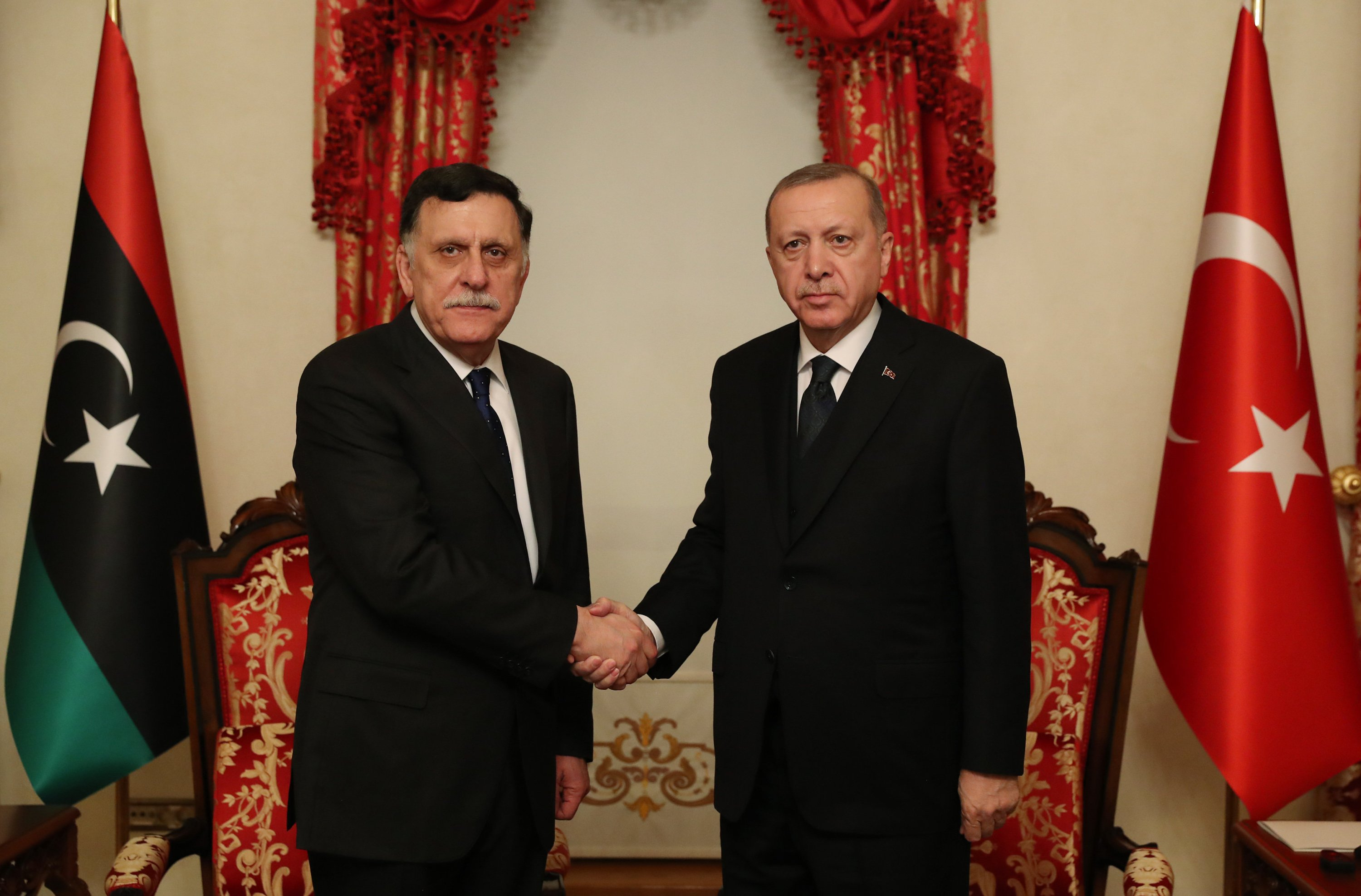 President Recep Tayyip Erdoğan shakes hands with the head of the Libya's GNA Fayez al-Sarraj during latter's visit to Istanbul, Feb. 21, 2020. (AA)