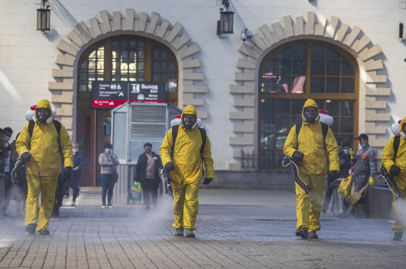 Russian Emergency Situations Ministry workers sanitize Kazansky Railway Station, Moscow, May 28, 2020. (EPA Photo)