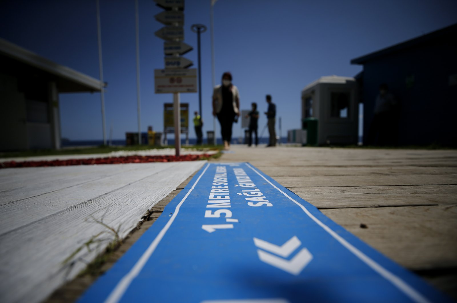 """""""One and a half meters of social distancing protects your health,"""" reads a sign in Turkey's touristic Antalya province where a number of measures against the coronavirus pandemic were taken with social distancing to be observed even while swimming, May 29, 2020 (AA Photo)"""