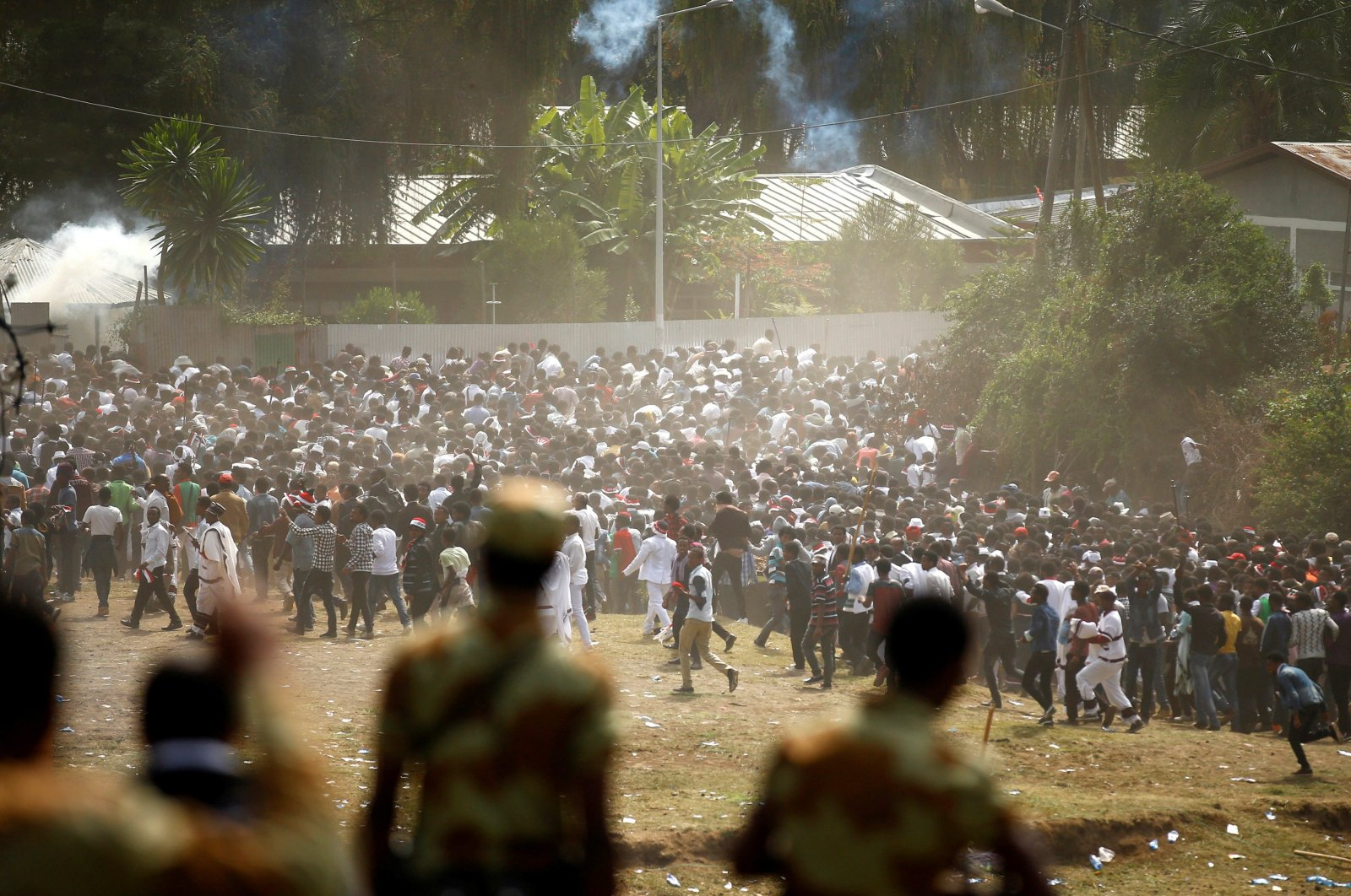 Protestors run from teargas launched by security personnel during the Irecha, the thanksgiving festival of the Oromo people, Bishoftu, Oromia region, Ethiopia, Oct. 2, 2016. (Reuters Photo)
