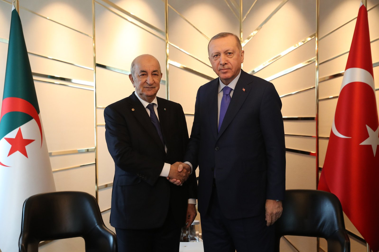 President Recep Tayyip Erdoğan shakes hands with Algerian President Abdelmadjid Tebboune ahead of a conference over Libya in Berlin, Jan.21, 2020. (IHA)