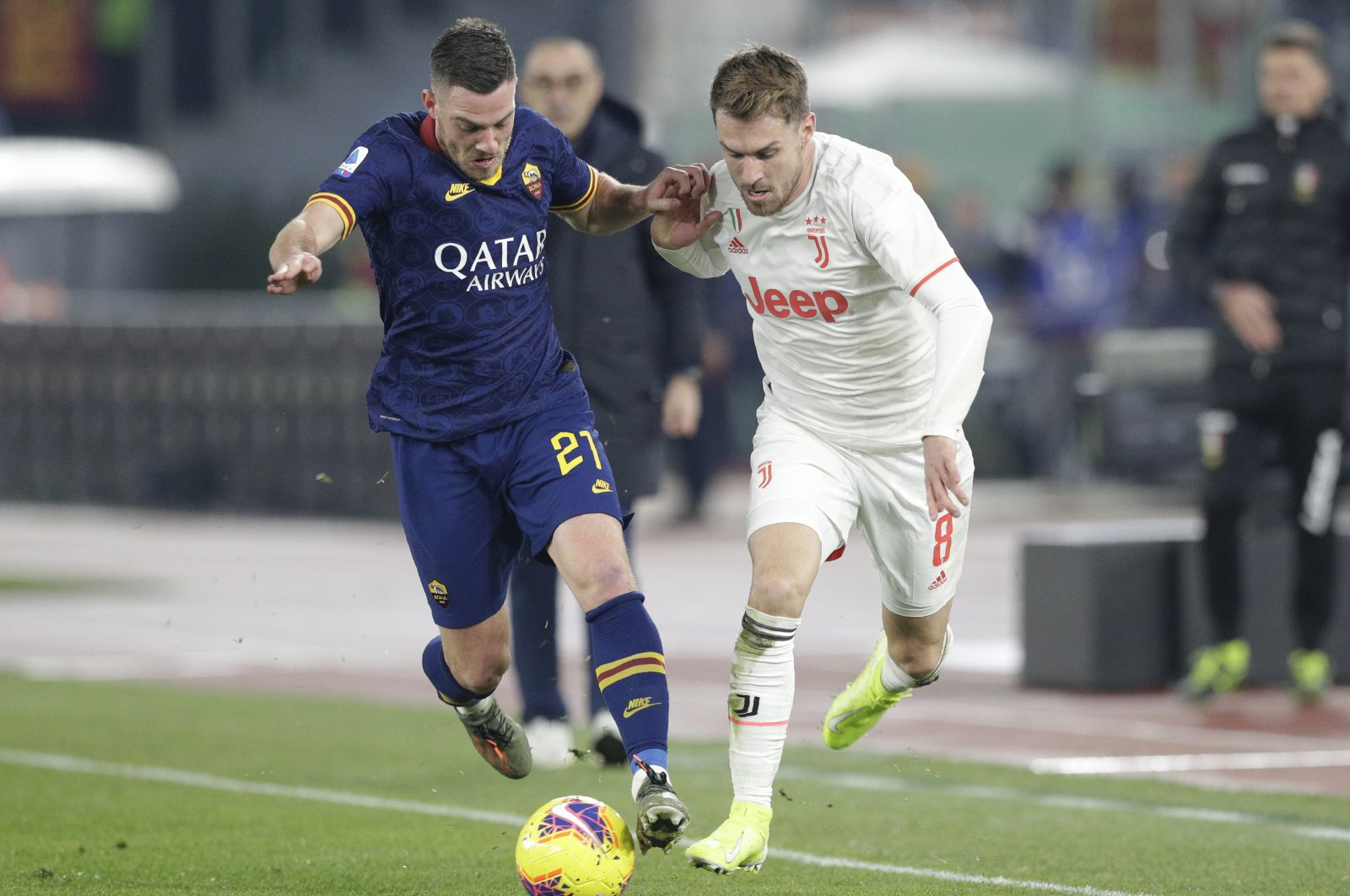 Roma's Jordan Veretout, left, and Juventus' Aaron Ramsey challenge for the ball during a Serie A match in Rome, Italy, Jan. 12, 2020. (AP Photo)