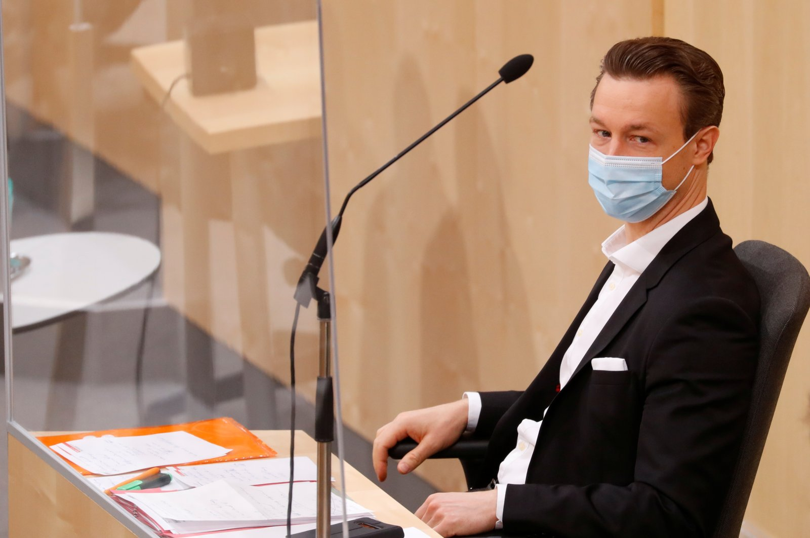 Austrian Finance Minister Gernot Bluemel wearing a protective face mask waits for the start of a session of the parliament, Vienna, May 26, 2020. (Reuters Photo)