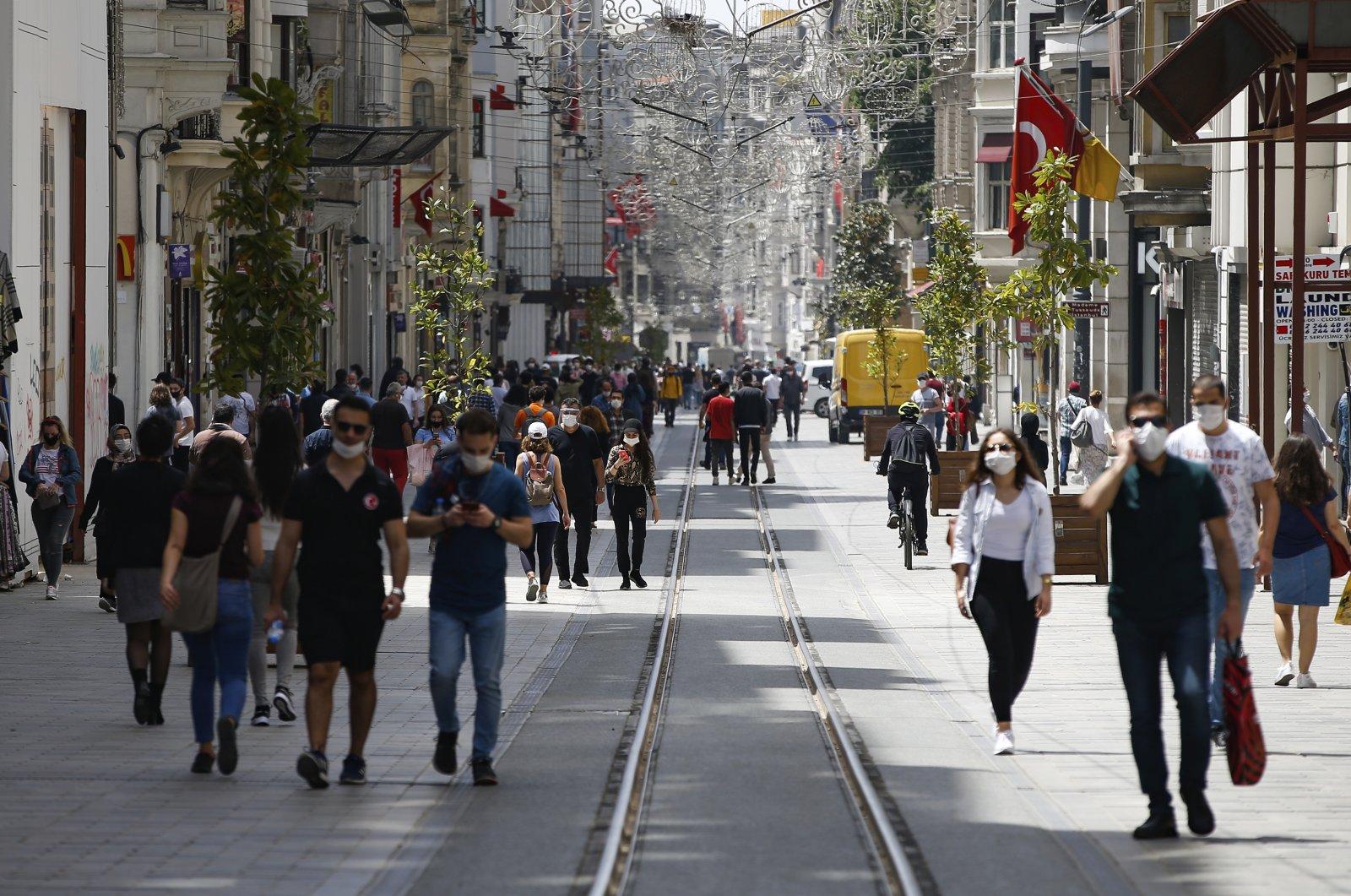 People walk along Istiklal Street near Taksim Square, Istanbul, Turkey, May 15, 2020. (AP Photo)