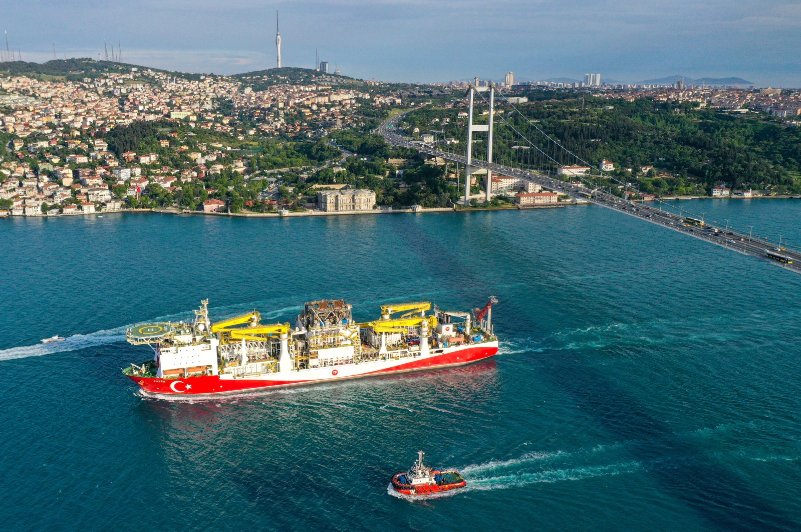 Turkey's first drilling vessel Fatih sails under July 15 Martyrs Bridge, formerly known as the Bosporus Bridge, as it leaves for the Black Sea, Istanbul, Turkey, May 29, 2020. (AA Photo)