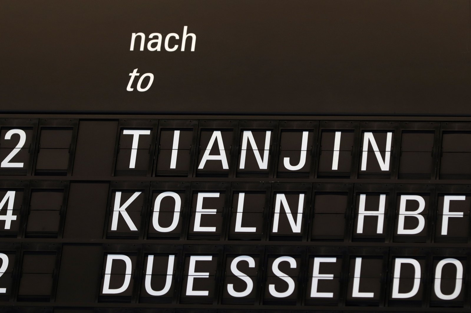 A screen showing Lufthansa flight LH 342 to Tianjin, China (the first post-lockdown flight departing Europe for China) is pictured at the airport in Frankfurt am Main, western Germany, on May 29, 2020. (AFP Photo)